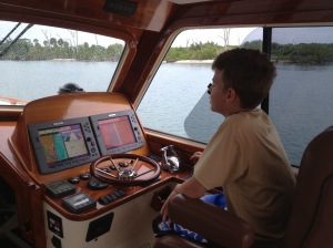 "A captain in the making.  The best advise a can give him is to, ""only approach something as fast as he want's to hit it"".  Look at the farce concentration.  He stood a 3 hour watch running the boat up the ICW in South Florida."